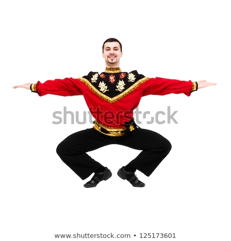 Attractive young dancer wearing a folk russian costume posing Stock photo © stepstock
