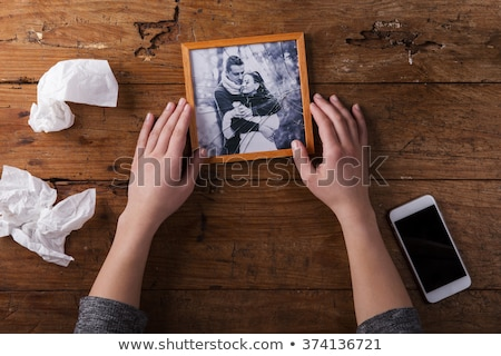 Woman holding a romantic picture Stock photo © stryjek