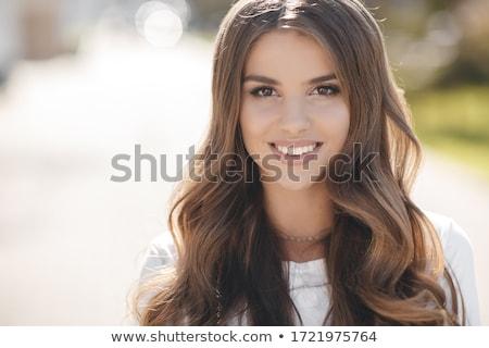 Closeup of beautiful young lady stock photo © get4net