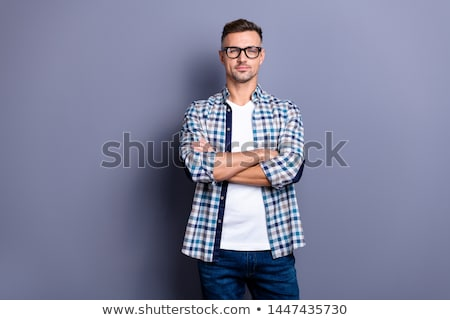 young smiling confident guy stock photo © stockyimages