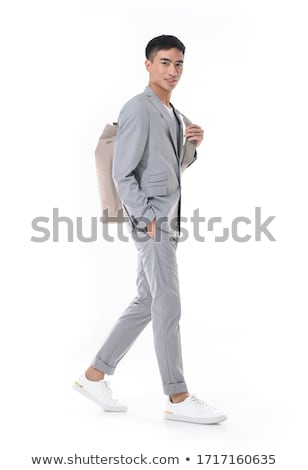 Corporate guy posing with clasped hands Stock photo © stockyimages