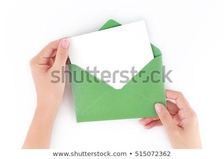 green envelope with cards isolated on white background Stock photo © natika