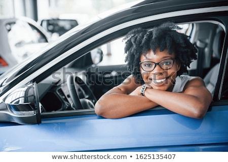 beautiful young woman in a car stock photo © amok