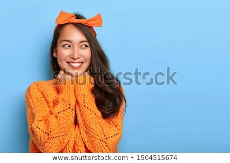 sorridente · asiático · mulher · mão · queixo · olhando - foto stock © bmonteny