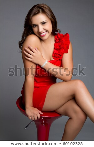 Portrait of stunning young Latino girl in red Stock photo © darrinhenry