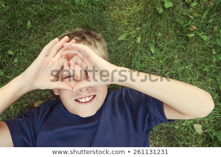 boy with heart in his hands outdoor stock photo © anna_leni
