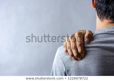 moço · sofrimento · dor · no · ombro · retrato · sessão · cama - foto stock © andreypopov
