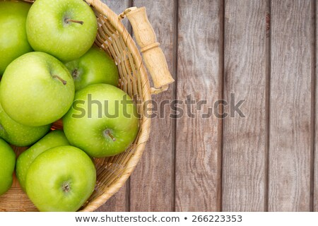 Wicker basket of crisp green apples Stock photo © ozgur