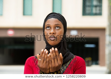 Close up of young Muslim girl praying Stock photo © ziprashantzi