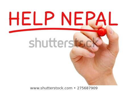 Helpen Nepal Rood fiche hand schrijven Stockfoto © ivelin