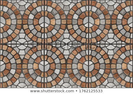 gray and brown pavement in the form of a circle stock photo © tashatuvango