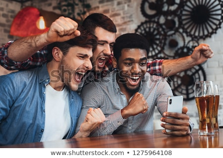 Young man shouting on smartphone Stock photo © deandrobot