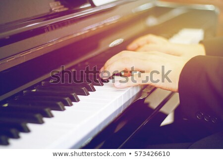 woman plays the piano at sunset Stock photo © adrenalina