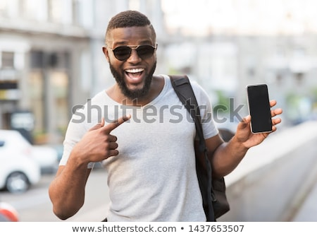 Stock photo: Business man showing phone