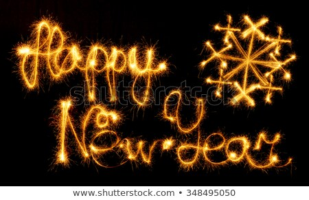 Happy New Year - 2016 with snowflakes made by sparklers on black Stock photo © vlad_star