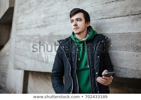 Portrait of a casual man in hood Stock photo © deandrobot