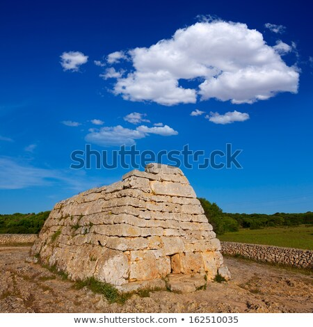 Naveta des Tudons - ancient megalithic chamber tomb at Menorca i Stock photo © tuulijumala