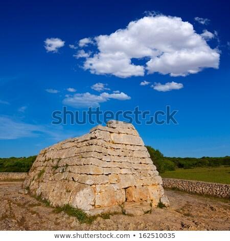 Naveta des Tudons - ancient megalithic chamber tomb at Menorca i Stock photo © tuulijumala