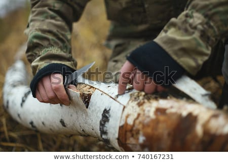 close up of soldier or hunter with knife in forest Stock photo © dolgachov