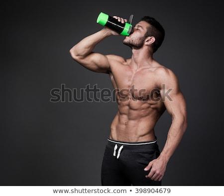 человека Культурист шейкер напитки позируют Сток-фото © restyler