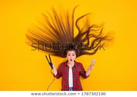 Hairbrush isolated on checkered background Stock photo © m_pavlov