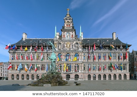 Antwerp's city hall with the Brabo fountain Stock photo © artjazz