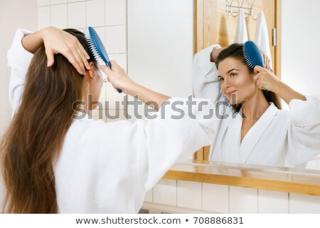 Girl With A Mirror Combing Her Hair stock photo © MilanMarkovic78