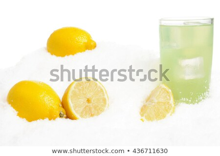 Glass of lime juice with ice cubes on snow on white Stock photo © dla4