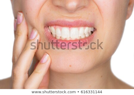 Doente mulher jovem dor de dente tocante dentes imagem Foto stock © deandrobot