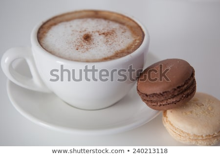 Close up of Cup of Cappucino with an Amaretti Biscuit
