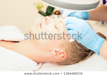 Beautician makes the procedure for  cleaning woman face Stock photo © vlad_star