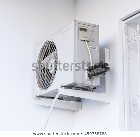 External air conditioner unit on white wall Stock photo © stevanovicigor