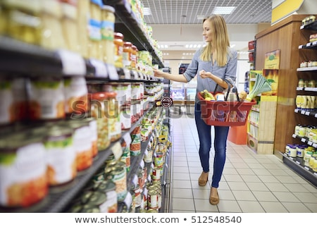 Woman shopping in supermarket aisle stock photo © monkey_business