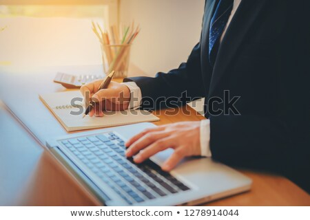 Working process startup. Businessman working at the wood table w stock photo © snowing
