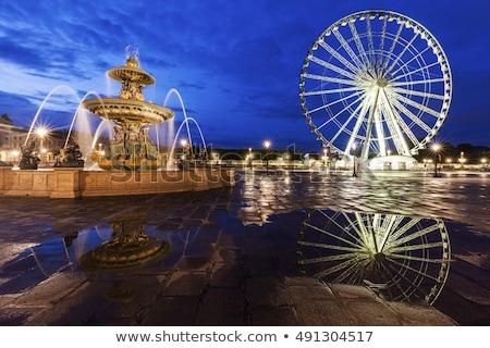 Fontaine des Fleuves and Ferris Wheel on Place de la Concorde in Stock photo © benkrut
