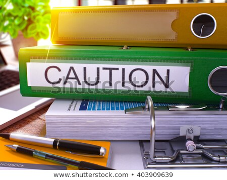 green office folder with inscription caution stock photo © tashatuvango
