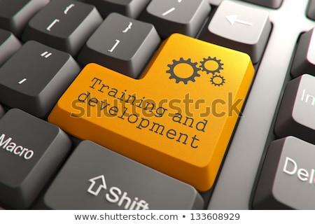 esbelto · alumínio · teclado · mão · tocante - foto stock © tashatuvango