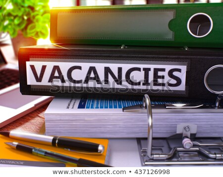 Vacancies on Black Ring Binder. Blurred, Toned Image. Stock photo © tashatuvango