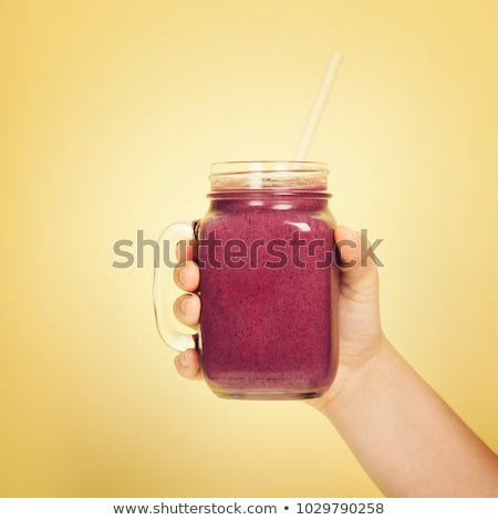 Vidro suco beber adolescente Foto stock © monkey_business
