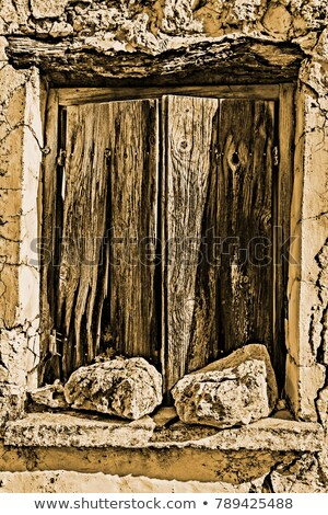 Old wodden window shutter of traditional house in the village Chamaitoulo, Crete, Greece Stock photo © ankarb