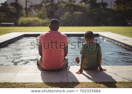 african father son swim stock photo © lienkie