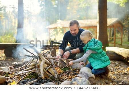 Fille feu de camp femme homme nature été Photo stock © IS2