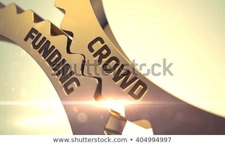 golden gears with crowd funding concept 3d illustration stock photo © tashatuvango