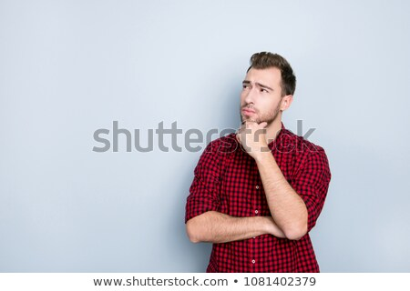 handsome young man with red checkers shirt and rolled sleeves Stock photo © feedough