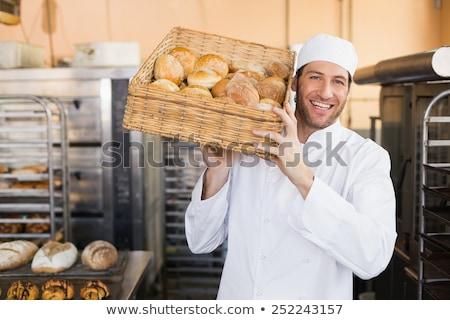 Male staff holding a basket of bread Stock photo © wavebreak_media