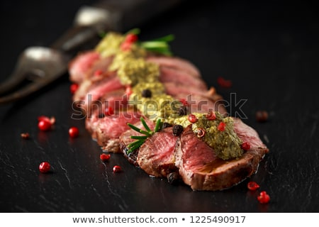 Meat steak with green pesto stock photo © Melnyk