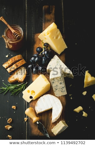assorted cheeses on wooden board stock photo © melnyk