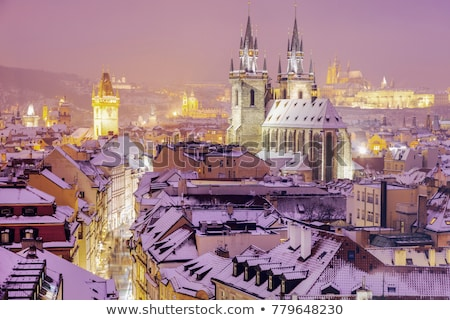 winter in prague   city panorama with tyn cathedral and clock to stock photo © benkrut