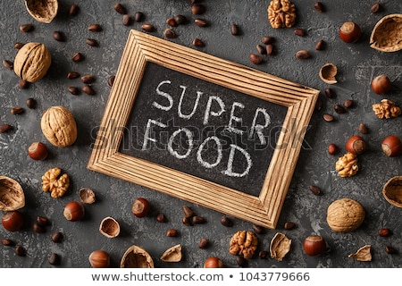 Inscription Super Food, Various nuts on stone table Stock photo © Valeriy
