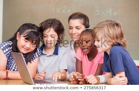 tanár · diákok · osztályterem · gyerekek · tanul · gyerekek - stock fotó © bluering
